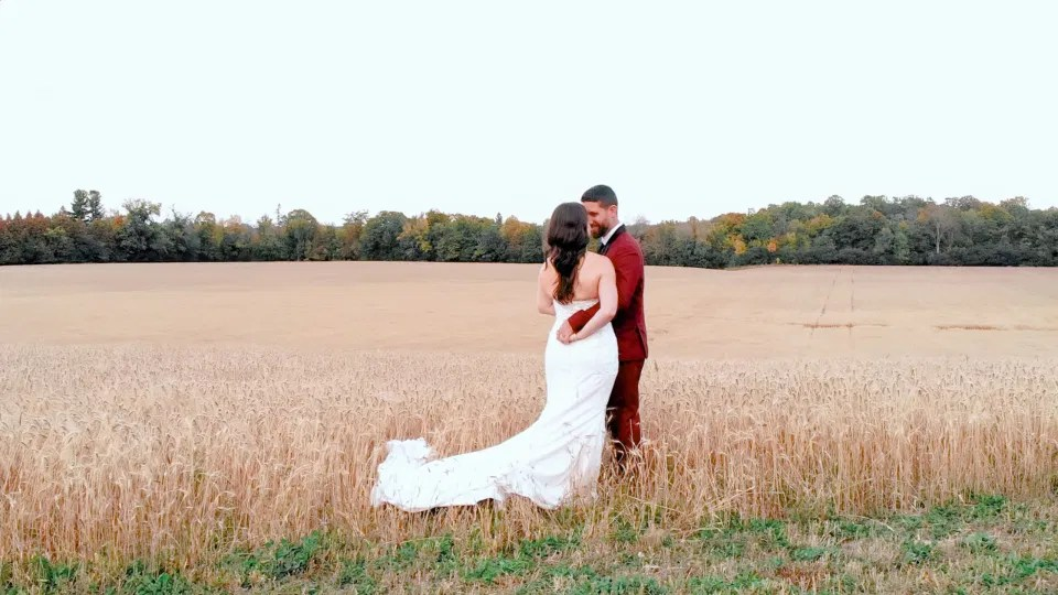 Bride and Groom Posing in Field of Wheat - Ruby, Off-White, Silver, Greenery. Eucalyptus Leaves. An inspiration filled with soft neutrals, lush florals, and layers of romantic textures all set at Evermore Weddings and Events, Almonte Ontario.  Grey Loft Studio shot with Canon 5D Mark 4. Ottawa Wedding Photographer & Videographer Team.