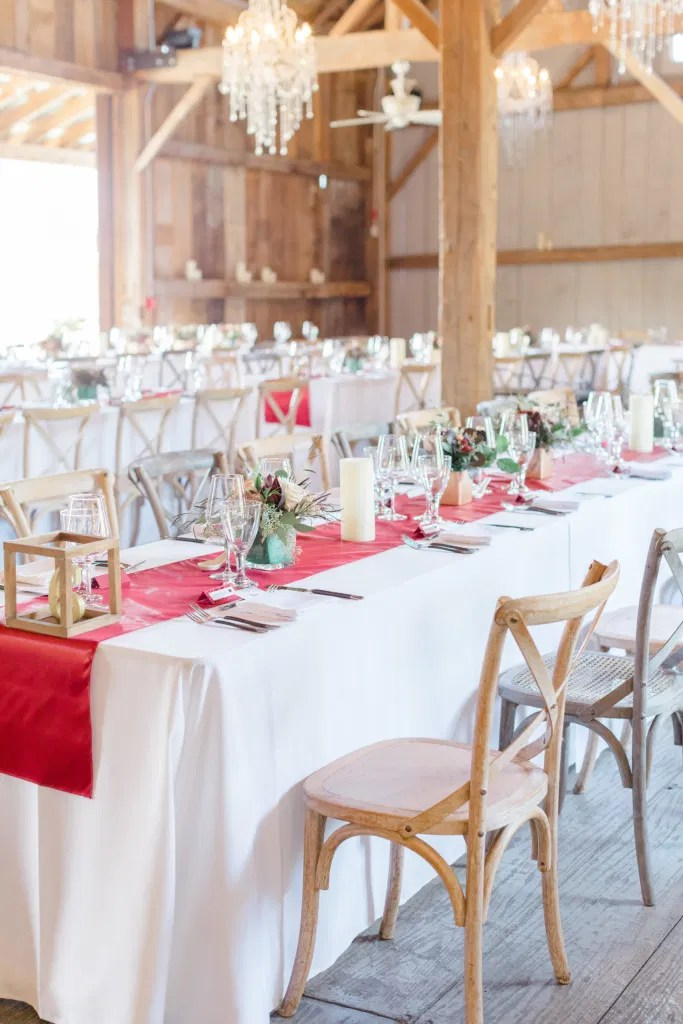 Indoor Heritage Barn at Evermore Wedding's and Events - Almonte - Hanging Chandeliers, Rustic Modern Chairs, White linens. Ruby Red Lovely Wedding at Evermore.
