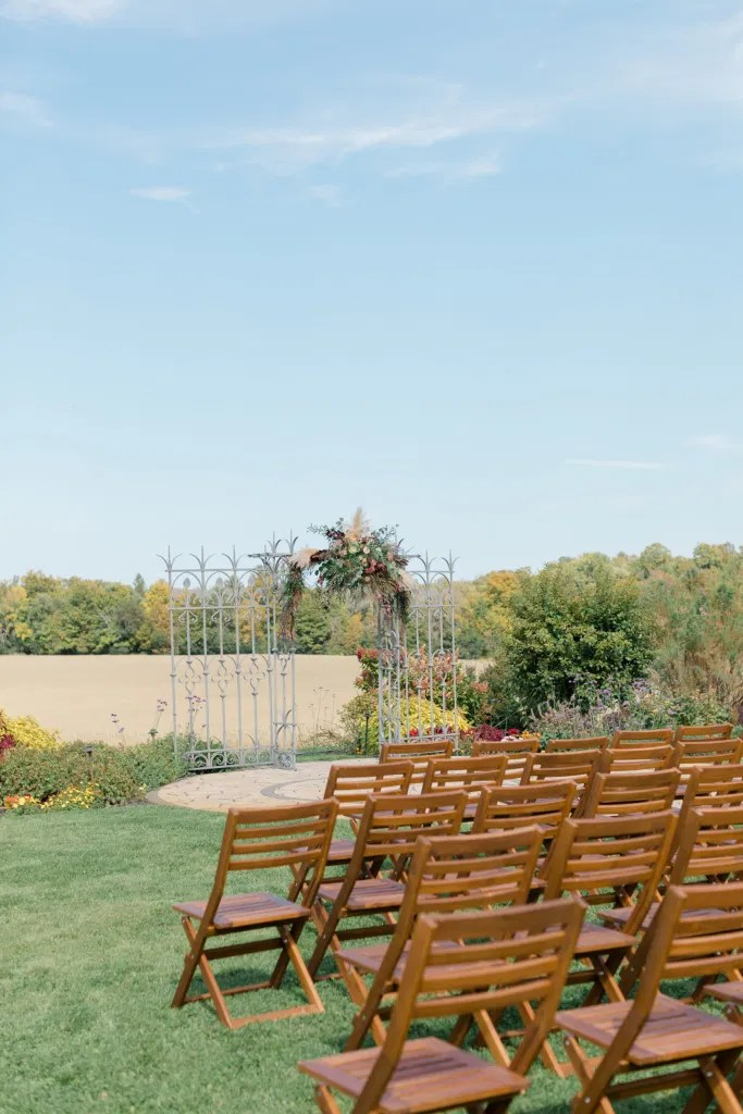 Beautiful Landscapes with beautiful Ceremony Decor -Floral inspiration - Outdoor Ceremony With Wooden Modern Brown Wood Chairs. Interlock, beautiful Landscapes at Evermore Weddings and Events, Almonte Ontario - Grey Loft Studio