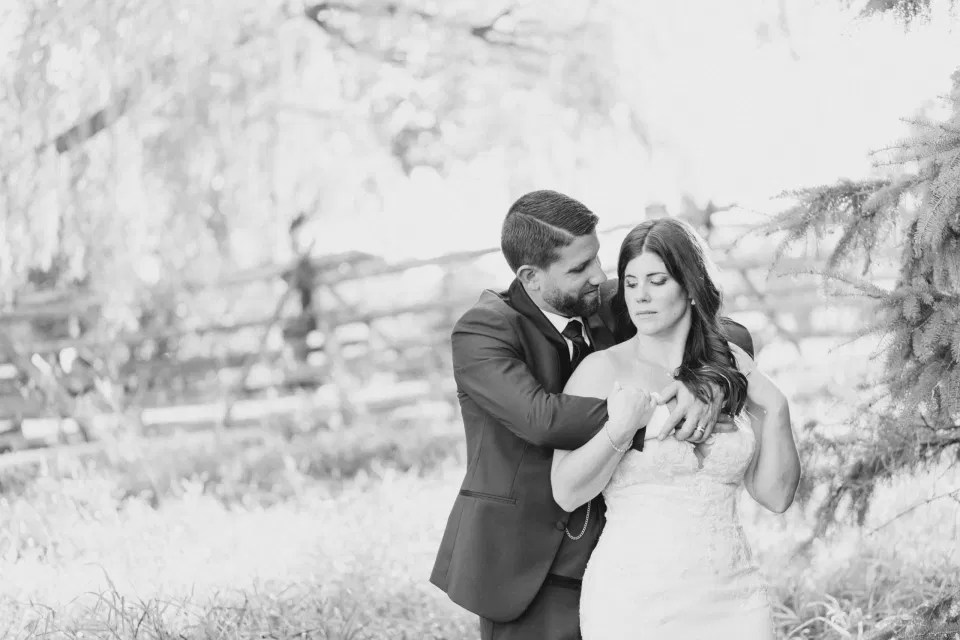 Black and White -  Bride and Groom - Standing in a Field - Off-White, Silver, Greenery. Eucalyptus Leaves. An inspiration filled with soft neutrals, lush florals, and layers of romantic textures all set at Evermore Weddings and Events, Almonte Ontario.  Grey Loft Studio shot with Canon 5D Mark 4. Ottawa Wedding Photographer & Videographer Team.