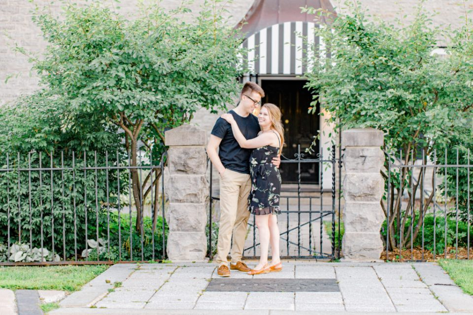 Cute Porch Session Ideas - Romantic Posing - Cute Posing for Tall guys with short girls - Engagement Photo Poses- Posing close to Rideau Hall - Ideas for what to wear for Engagement Photography, Modern Engagement Session Inspiration Wardrobe Ideas. Unsure of what to wear for your engagement photos, we've got you! Romantic floral dress. Black Polo T-shirt & neutral pants . Boat Shoes and Fancy beaded wedges. Engagement downtown Ottawa. Grey Loft Studio is Ottawa's Wedding and Engagement Photographer Videographer for Real couples, showcasing photos that are modern, bright, and fun. Photographe Gatineau -Posing on the Ottawa River