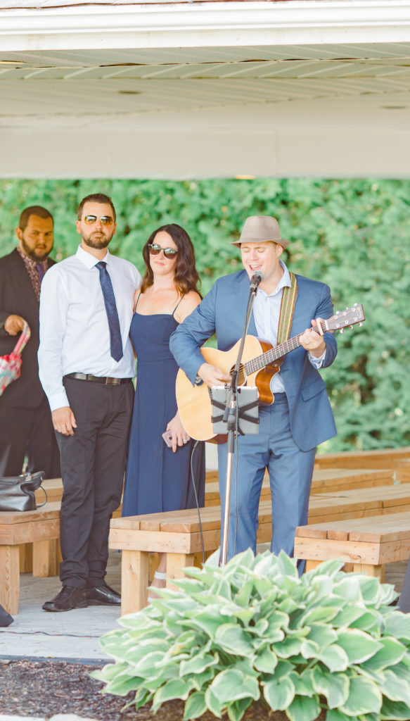Dylan Holton Singing Live at Wedding - Detail Photos for Micro Wedding - Ideas for what to wear for Wedding Photography, Modern Wedding Inspiration. Romantic Micro Wedding Orchard view - Grey Loft Studio is Ottawa's Wedding and Engagement Photographer for Real couples, showcasing photos that are modern, bright, and fun. Petite Wedding, Elopement Wedding, COVID Wedding Inspiration 2020
