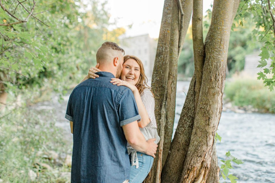 Laugh full of love- engagement session - Watson's Mill Engagement Session Manotick - Bright & Airy photography - Grey Loft Studio - Ottawa Wedding Photographer - Ottawa Wedding Videographer - Engagement Session Locations in Ottawa - Summer Engagement session - Light blue and Cream with casual jeans and strap sandals. Ottawa Photo Studio.