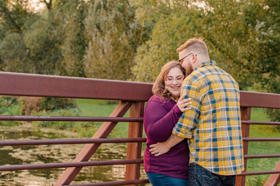 Cute pose on the Bridge - Engagement Session - Ottawa Wedding Photographer - Grey Loft Studio - Wedding in Ottawa - Yellow & Plaid with Burgundy Knit Sweater and Jeans