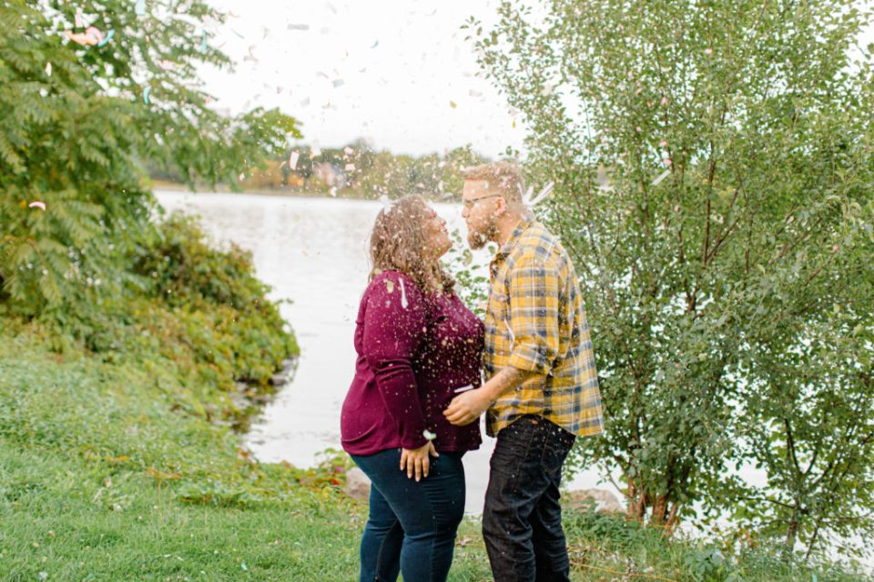 Confetti Kiss during a Session - Ottawa Wedding Photographer - Grey Loft Studio - Wedding in Ottawa - Smoke Bombs & Confetti during Photo Session Yellow & Plaid with Burgundy Knit Sweater and Jeans