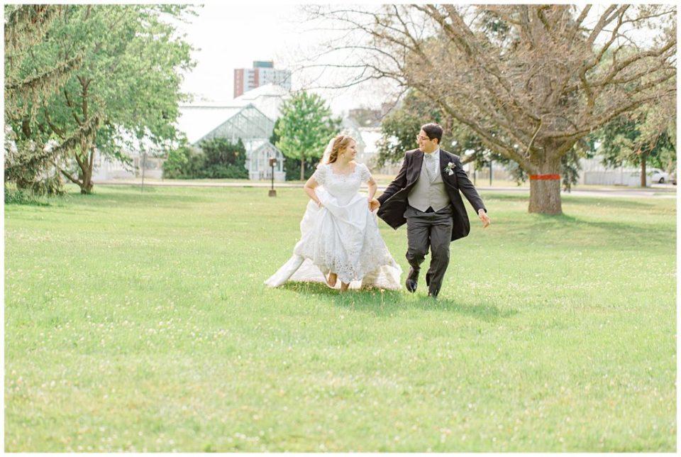 Bride and Groom running -  Ornament Garden Ottawa - Bride and Groom Portraits -  Ottawa - Wedding Day - Grey Loft Studio - Wedding Photographer - Wedding Photographer near me