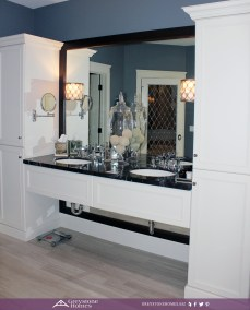 traditional bathroom white cabinetry mirror behind vanity
