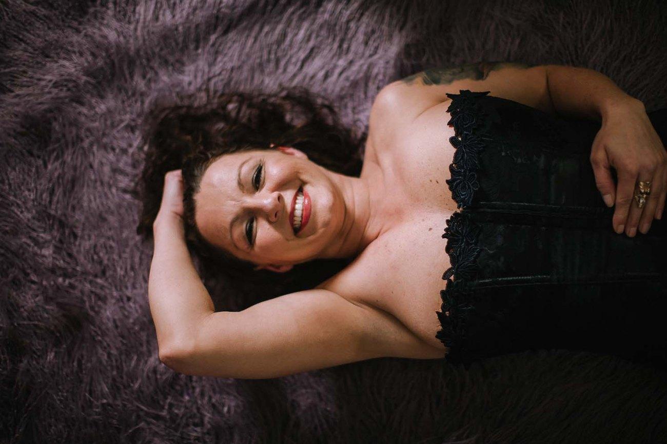 Woman classy adult boudoire photography with purple faux fur throw prop. Saint Paul photo studio, natural light intimate portrait. Saint Paul Boudoir Photography
