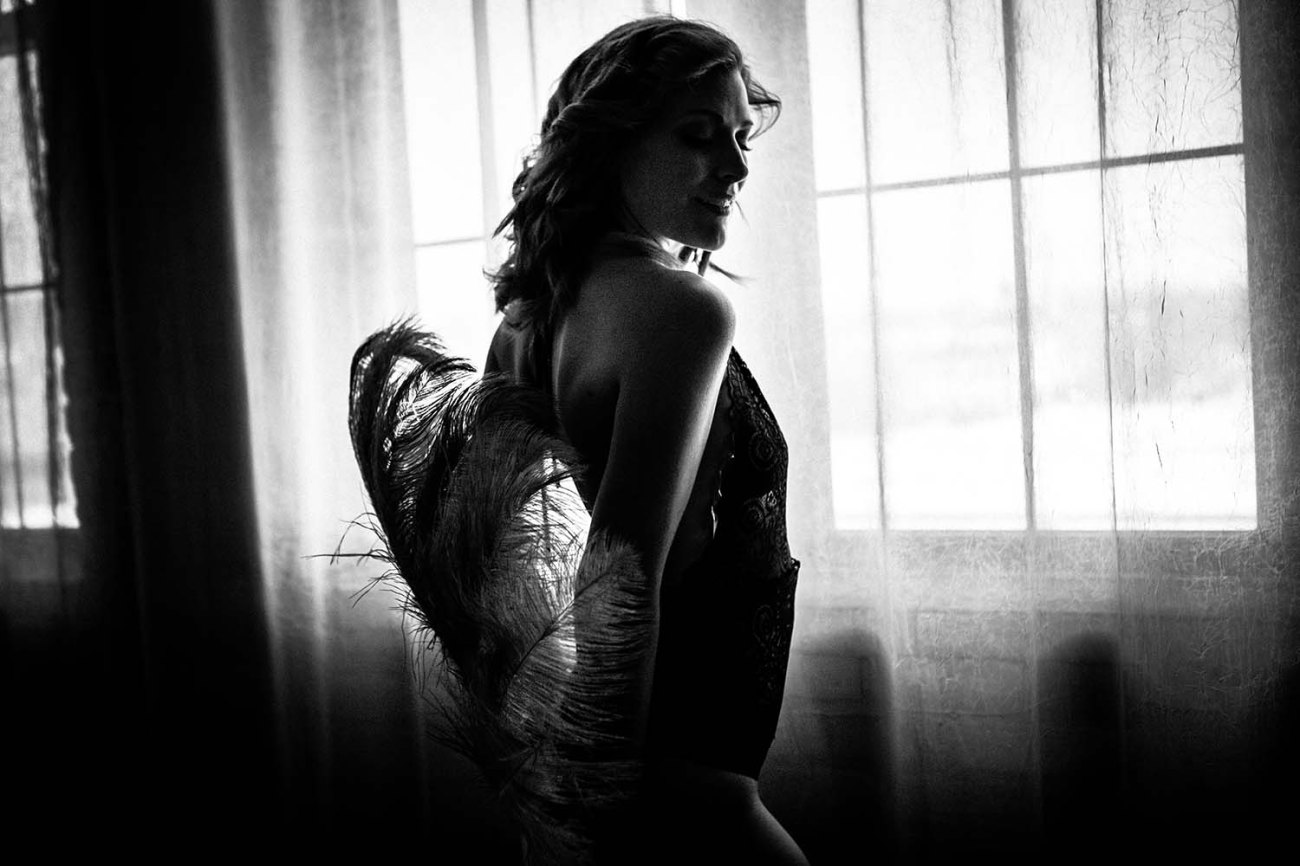 Black and White boudoir photography with Burlesque Fan, and using natural window light, Twin Cities; MN photographer