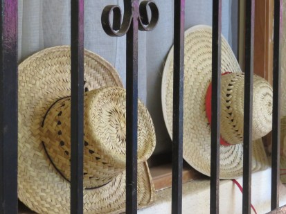 past two hats that look like they are being punished––