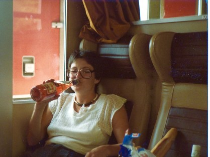 This is Judy G on the train to Spain. As I recall, we had a bit of a problem getting that bottle open as we hadn't brought an opener. I think the cork was still intact when I took this picture.