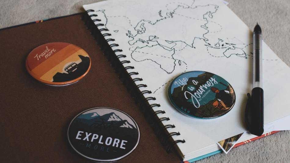 Image of a travel journal and a pen.