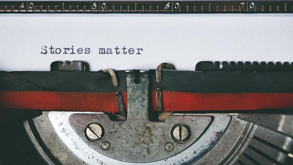 "Typewriter with the words ""Stories matter"""