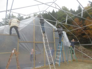 Attaching the double layer of plastic to the main greenhouse