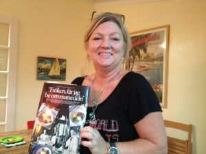 Millis shows off her Swedish Cookbook that she brought to the first Cookbook Club meeting.