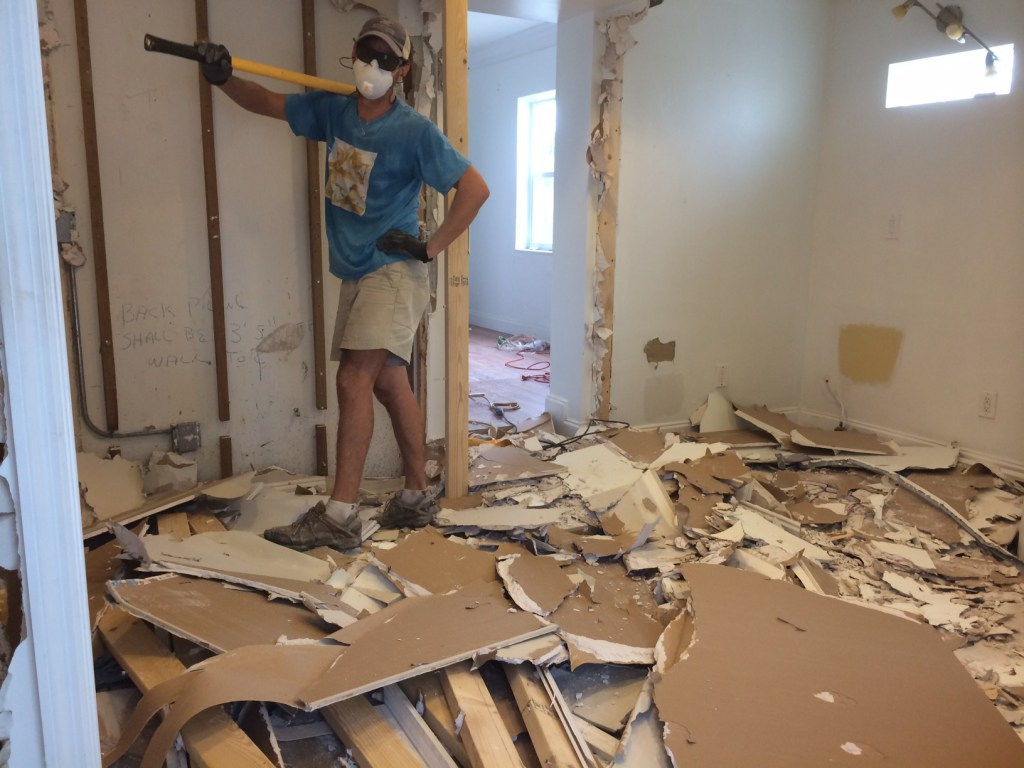 This is what used to be our bathroom (husband Scott holding the sledgehammer)