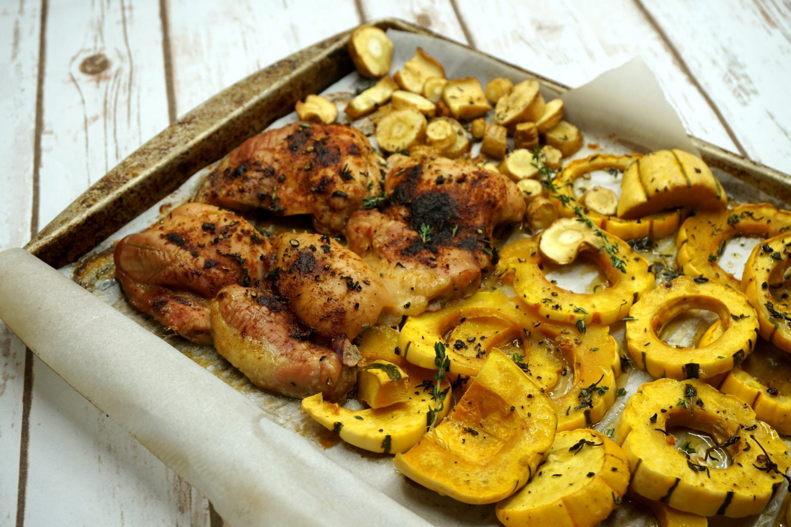 Pellet Smoker Sheet Pan Dinner: Smoked Chicken Thighs with Maple Thyme Glazed Delicata Squash