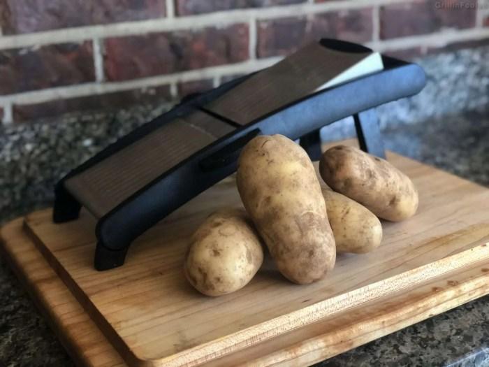 A mandolin and potatoes