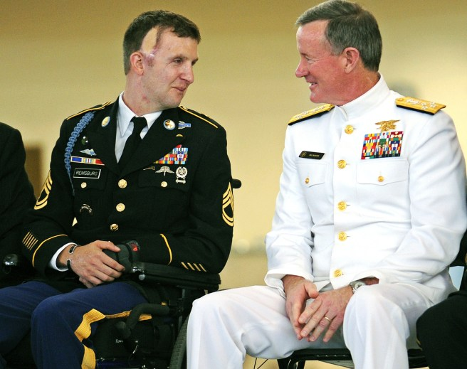 Sgt. Cory Remsburg, USA, speaks with Admiral William McRaven, during Remsburg's 2014 retirement ceremony. An Army Ranger, Remsburg was severely wounded in a 2009 firefight with enemy forces in Afghanistan. He has since become a national figure who was highlighted during President Obama's 2014 State of the Union Address. (AP Photo/Savannah Morning News, Corey Dickstein)