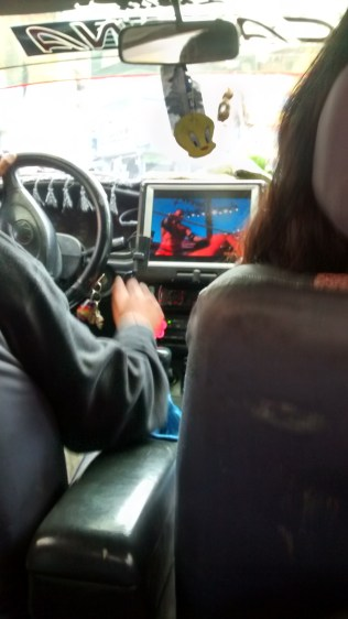 Watching WWE while driving. source: gringoinbolivia.