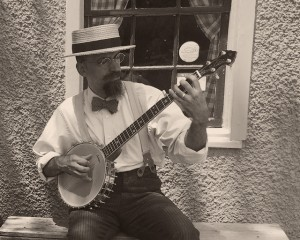 Photo of Andy Chase playing banjo