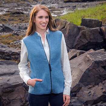 female model wearing womens alpaca sweater vest in sky blue