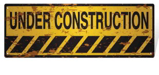 beat up under construction sign