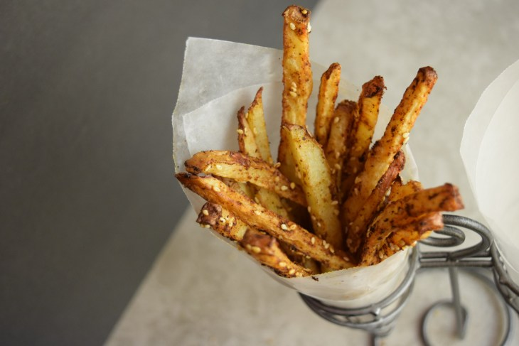 Spicy pomme frites also called baked spicy french fries with sesame seeds