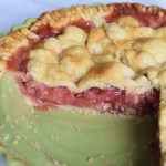Strawberry Rhubarb Pie with slices taken out of a green pie dish