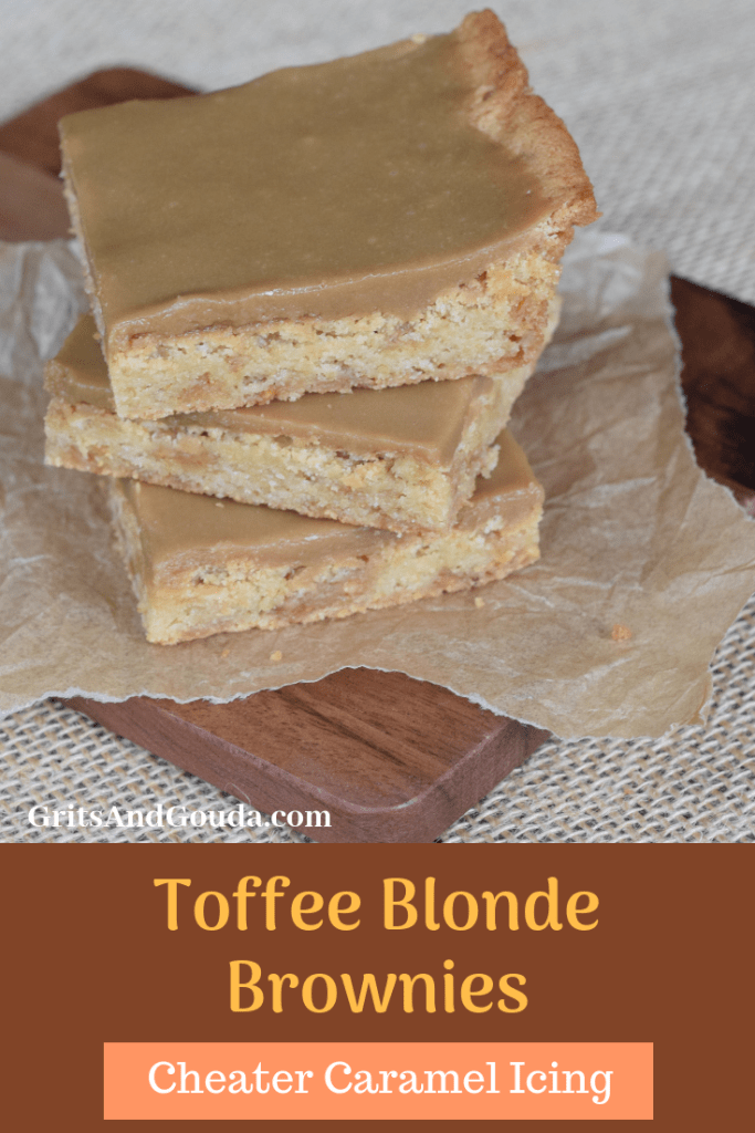 Stack of 3 Toffee Blonde Brownies with Cheaters Caramel Icing served on a dark brown wooden cutting board