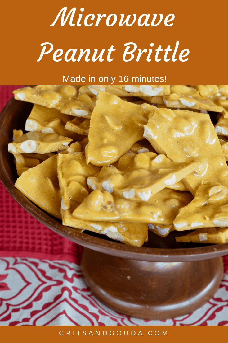 Easy Microwave Peanut Brittle in 16 minutes piled up on a wooden cake stand