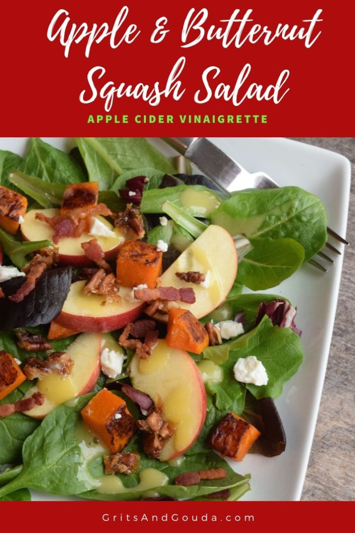 Apple slices roasted butternut squash with mixed lettuces on square white plate and fork