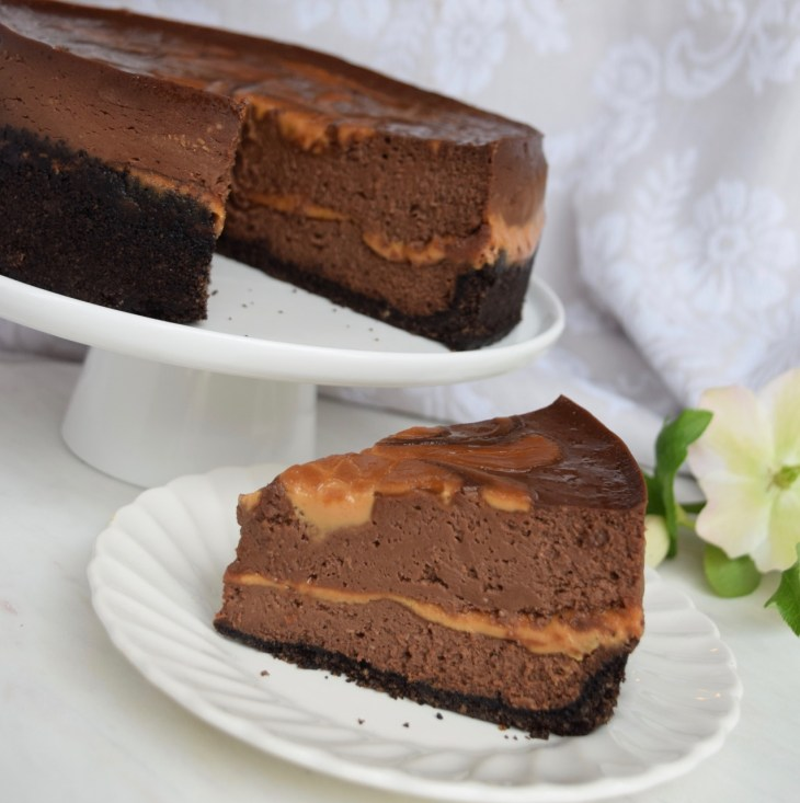 Instant Pot Chocolate Peanut Butter Swirl Cheesecake is the most decadent cheesecake for peanut butter lovers. Never cracks! Slice out onto white plate