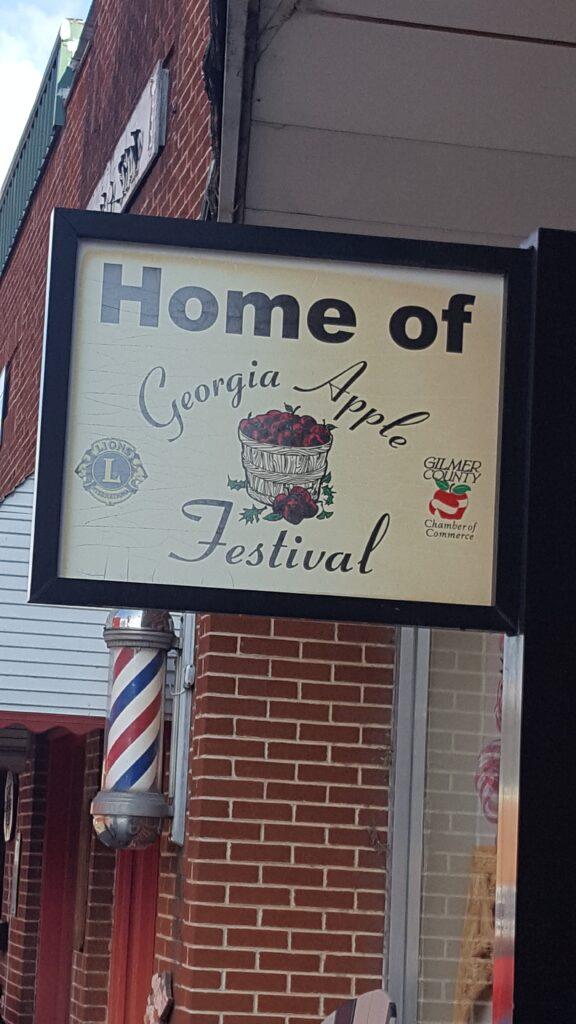 home of apple festival sign