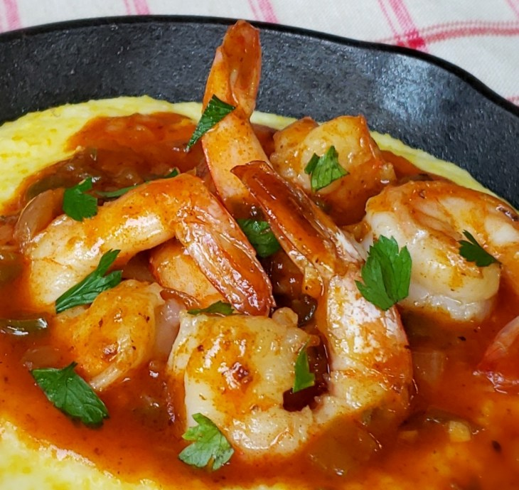 Close up view of Shortcut Shrimp and Grits in a cast iron skillet