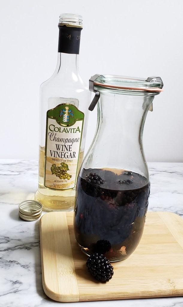 To make Blackberry Vinegar simply steep 1/2 cup of fresh blackberries in Champagne vinegar for 2 weeks in the fridge.