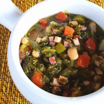 We Southerners love our greens-turnip greens. This dump and stir soup gets you in and out of the kitchen but tastes like you cooked them low and slow all day. Served in a white bowl.