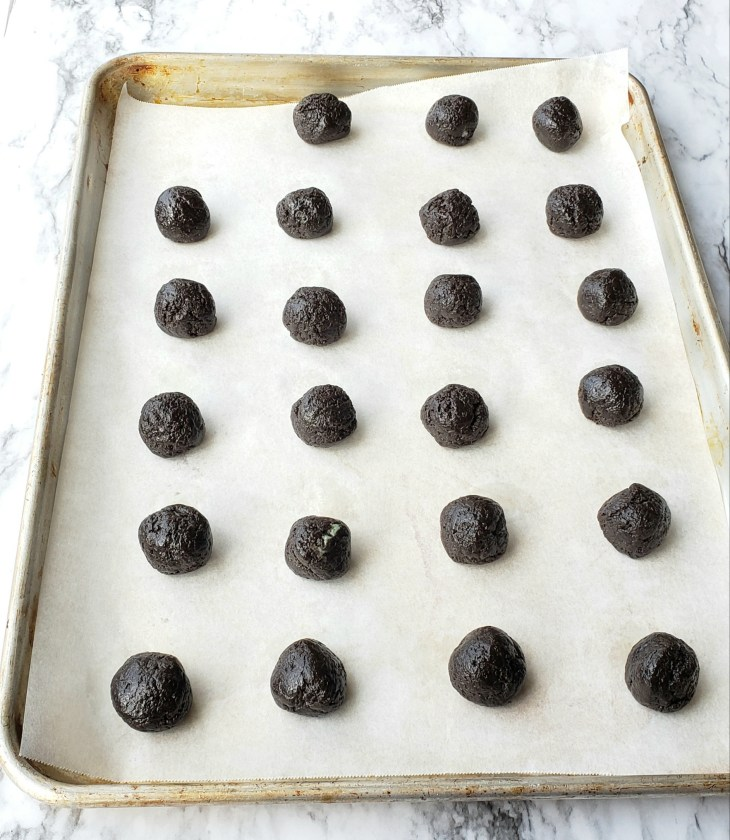 The next step is simply to finish rolling them into balls. I do refrigerate the balls at this point. This is convenient for me to make the Mint Oreo Truffle Balls ahead to this point. Then, when I have another available 30 minutes later in the day or the next day, I cover them with candy coating.