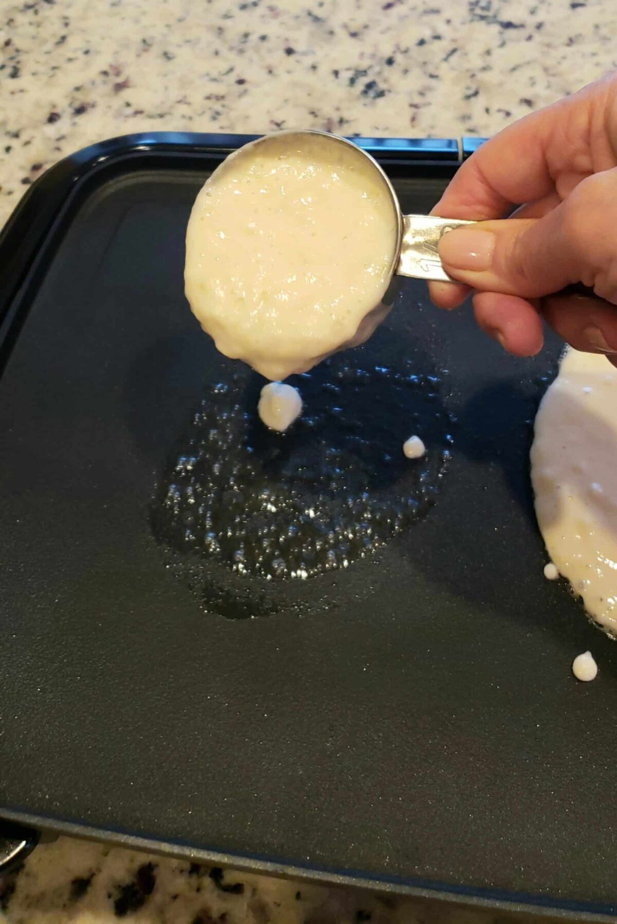 Pouring the pancake batter onto the griddle with a dry measuring cup is a great way to avoid dragging a spoon back and forth. That gets messy. This method makes sure they come out perfectly round-or closer to it!