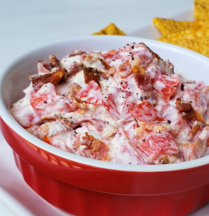 Bacon Tomato Dip with pepper close up few chips