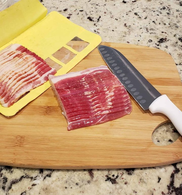 Cut a 12 oz package of bacon in half crosswise on a cutting board