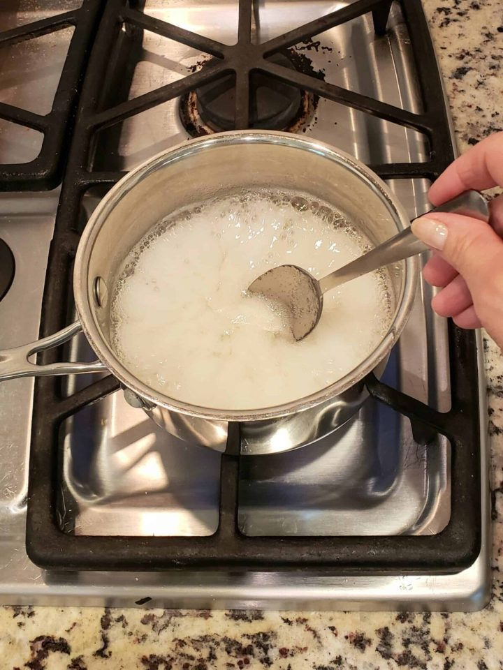 Combine pectin and water in a small saucepan and bring to a boil over a gas burner.