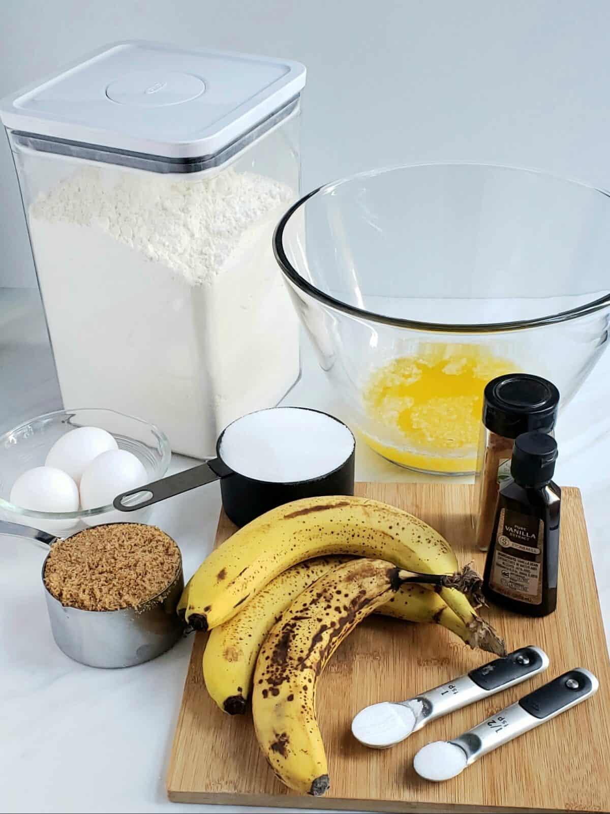 ingredients: flour, brown sugar, eggs, bananas, vanilla butter in a bowl
