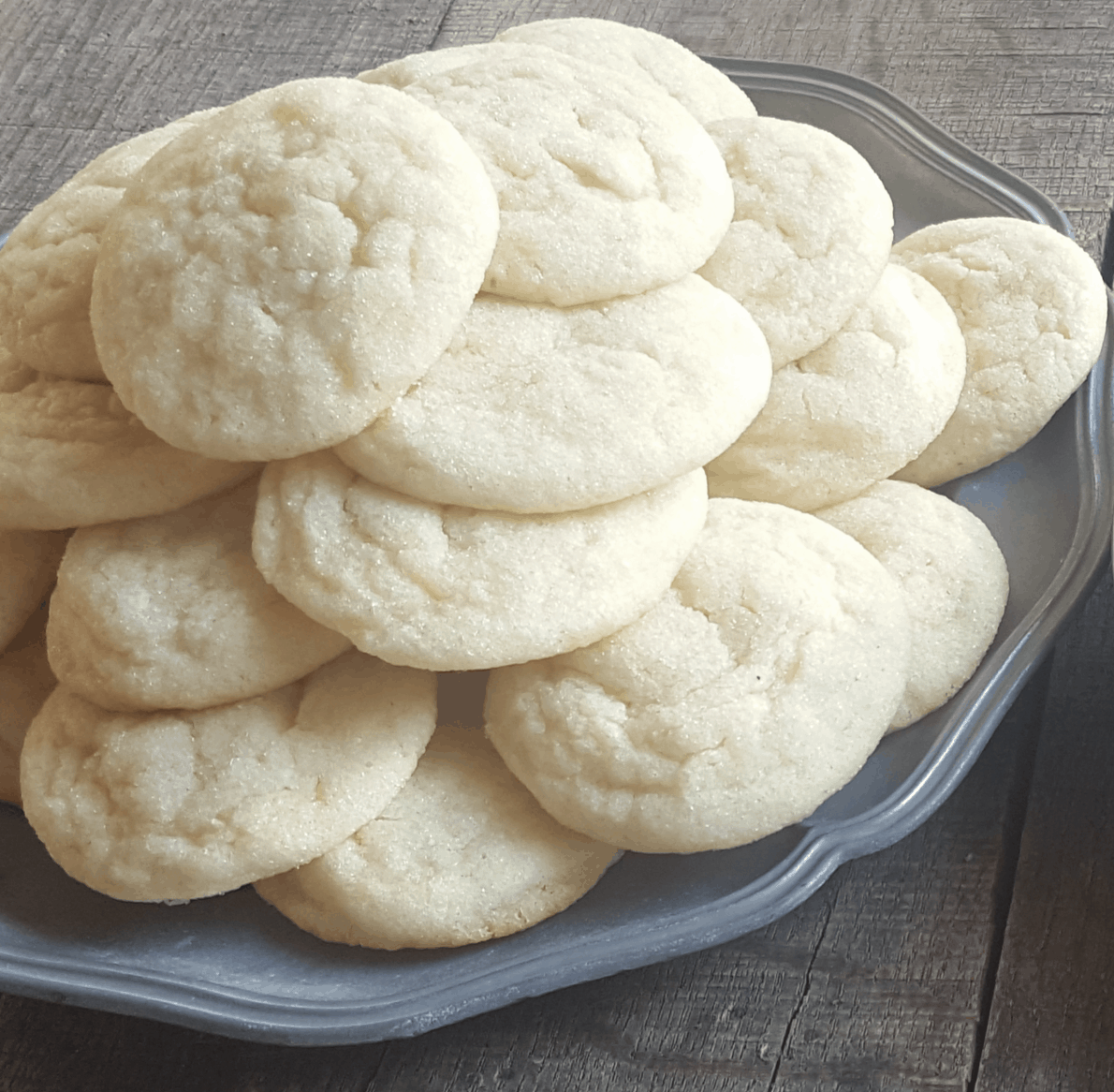 plate of sugar cookies on a pewter plate