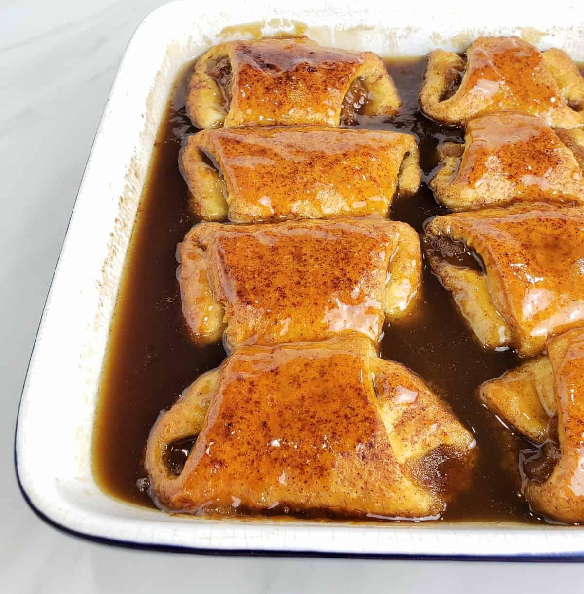 baked pumpkin dumplings in brown sugar sauce in square dish