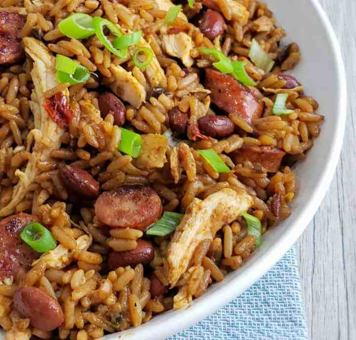 close up of chicken sausage jambalaya with green onions