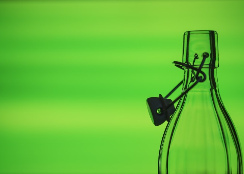 green background with empty bottle