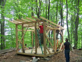 laying beams on roof of vermont timber frame