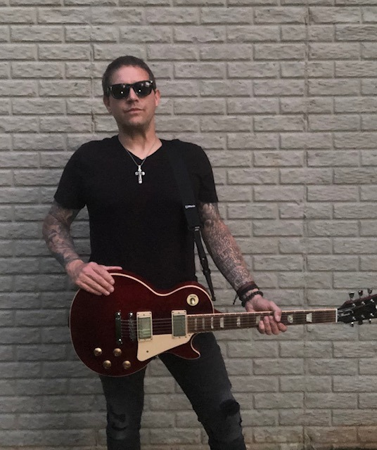 GROOVEMAG BEST NEW ROCK: Iron Maiden, Ozzy, AC/DC, Guns 'N' Roses and Alice in Chains collaborator 'Dave LeDoux' raises global issues and touches hearts on his classic well produced and rocking new release 'Broken'