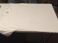 Adult shirt, spread out over a table. Try to remove as many wrinkles as possible. The more crisp the edges, the better the outcome.